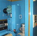 Auto load, transfer, chamfer & unload system. 300kg bar load, auto load-unload & transfer, auto diameter adjustment, utilises standard belts, operator interface.